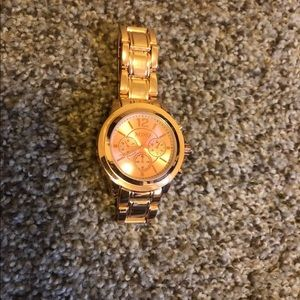 XOXO rose gold watch, never worn